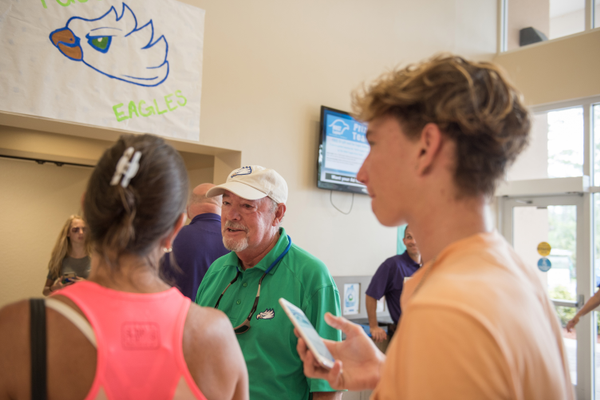 FGCU President Mike Martin greets freshmen at a campus dorm on move-in day in August 2017. Photo courtesy of FGCU.