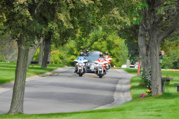 A police escort attends Mayor Ted Eyre's funeral (Photo/Rae Delliskave)