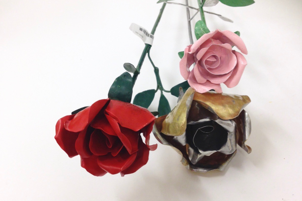 Red, gold two-toned, and pink metal roses