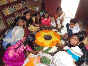 Making the Onam Pookkalam  Onam is a Kerala harvest festival celebrated by making a temporary mandala of flowers and rice and by feasting