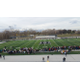 Students link arms around the football field at Highland High School on March 14 as part of the nationwide walkout. (Lori Gillespie/City Journals)