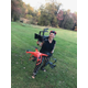 Flora Zanfrisco holds camera equipment including a drone that she uses in making her videos for her production company Freedom Films