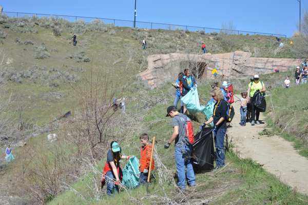 Volunteers help to clean up Dimple Dell Park on Earth Day.