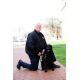 Lt. Harry McKinney and Melody. The English Labrador is trained as a comfort dog. (Photo by Jie Deng)