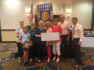 Members of the Rotary Club of Fort Myers South teamed with representatives from the Friends of the Fort Myers Library to present a check to the Lee County Library Systems Summer Reading Program on Monday April 30 Pictured from left are Jessica Reed Hannah Manibo Linda Yorde Nancy Petralia Helena Nesbit Ellen Ballard Steve Wassman and Greg Blurton Photo courtesy of the Rotary Club of Fort Myers South