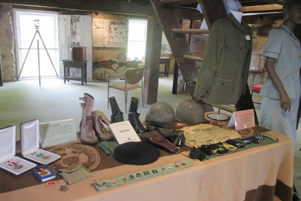 A display of uniforms and other items on the upper floor of the museum.