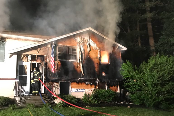 A 3-alarm fire Sunday night destroyed this home at 11 Herbert St. in Tewksbury (Rich MacDonald photo)