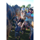 Families test their resolve by petting a walking T-rex. (Keyra Kristoffersen/City Journals)