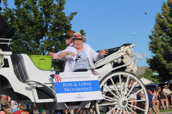 Ron and LaRae Broomhead toss candy to the crowd as grand marshals of the Riverton Town Days Parade. (Travis Barton/City Journals)