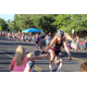 Members of the Salt Lake City Tri Club, which promotes triathlon in the community, run and ride bikes during the parade. (Travis Barton/City Journals)