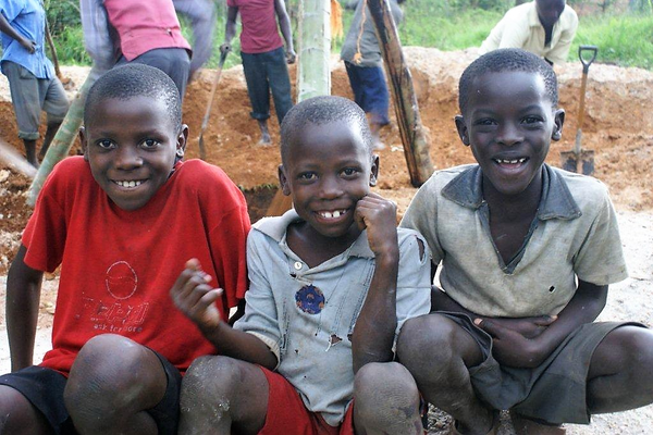 Ugandan children at the drill site.