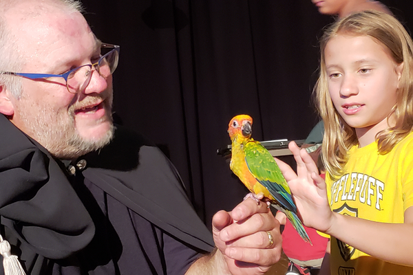 Emma Gratner, 9, got to an up-close look at a bird while visiting with wild things at Flamecrest Academy.