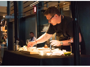 Chef Tyler Florence demonstrates how to make the main course during his visit to the Coopers Hawk Wine Club dinner in Naples
