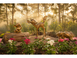 Sculptures of Bambi and other Disney characters populate green spaces