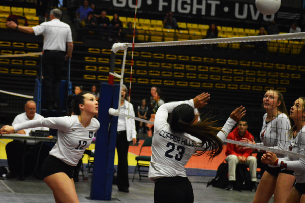 Aliyah Sopoaga fakes a set tipping the ball over the net at the state tournament. (Justin Adams/City Journals)