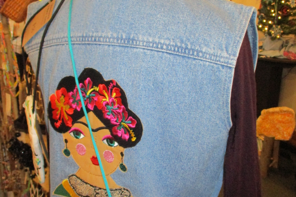 A denim vest with embroidery by Rosalie Wells.