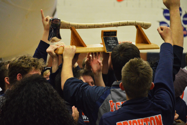 Bengal wrestlers lift the axe trophy in victory. (Justin Adams/The City Journals)