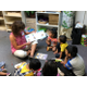 Lora Venturella reads to children in North Hills Cares summer reading program