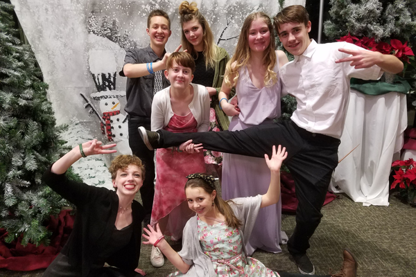 Teens stopped for a photo outside the dance arena at the Yule Ball, a formal dance for teens at the Viridian Event Center on Jan. 18.