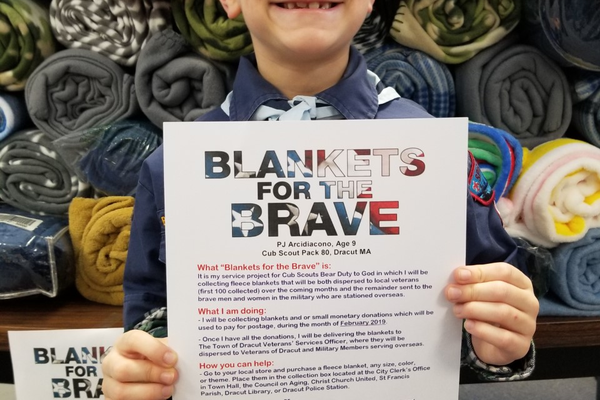 "Dracut Cub Scout P.J. Arcidiacono proudly displays the 101 blanket he collected for ""Blankets for the Bave.'' Courtesy photo by Robyn Arcidiacono."