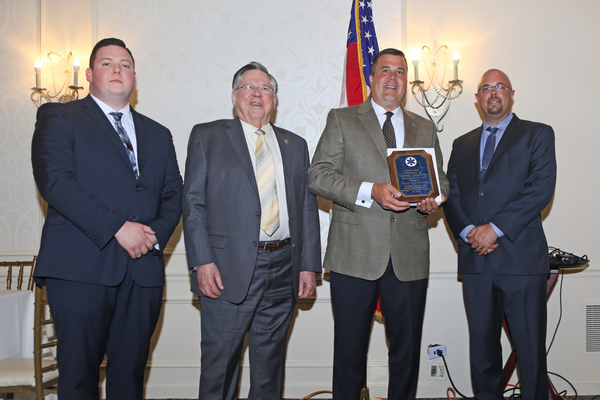 London Grove Township Supervisor Dave Connors (third from left) accepts the Thompson Award for outstanding service by a governmental official. From left are Charles Brogan, Chester County Association of Township Officials President Ernie Holling, Connors, and Gary Vinnacombe.
