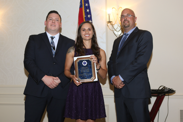 Kourtney Kluczynski with the Avondale Fire Company receives the Basic Life Support Award flanked by Charles Brogan on the left and Gary Vinnacombe on the right.