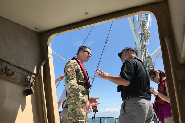 Col. Ed Chamberlayne, Baltimore district commander for the U.S. Army Corps of Engineers, speaks with Maryland Natural Resources Secretary Mark Belton on a ferry ride to Smith Island to view the completed jetties. (Jeremy Cox)