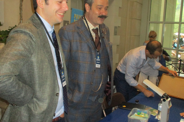 Nicholas Lowry (second from left) is a 'Roadshow' veteran known for his plaid suits and lighthearted appraisal style.
