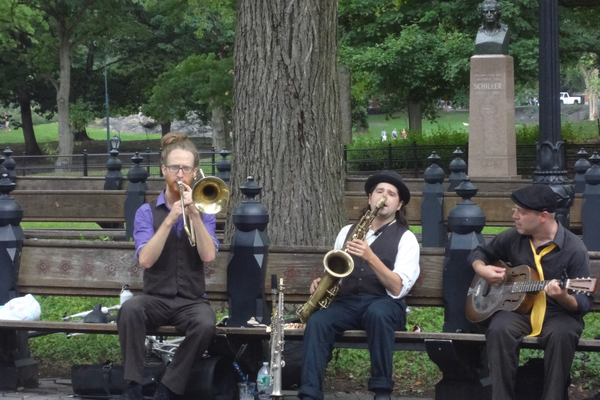 The bust of Schiller in Central Park takes in an impromptu jazz concert during the Faracy's visit.