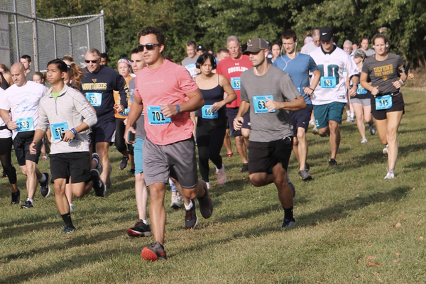Scores of runners compete in the 5K event on Sunday morning at Pennock Field.