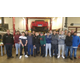 The Kennett students and teachers who worked on the Corvette are pictured in May of 2019 with the 75 Stingray on the lift