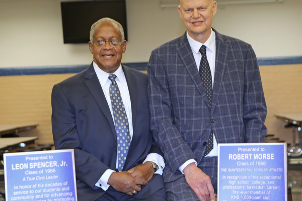 "Leon Spencer and Robert Morse stand behind facsimiles of the plaques naming them ""Kennett Legends."" The original plaques are on the wall of Legends Field."