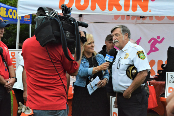 Bellingham Police Chief Jerry Daigle is interviewed during the Zip Trip (photo by Jen Russo)