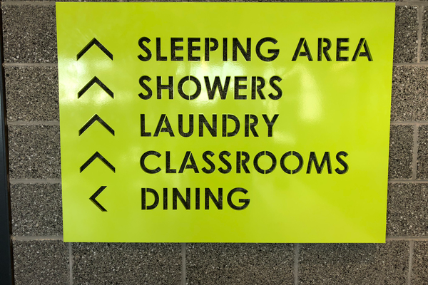 A directional sign showing areas in the new 1000 West Homeless Resource Center. (Bill Hardesty/City Journals)