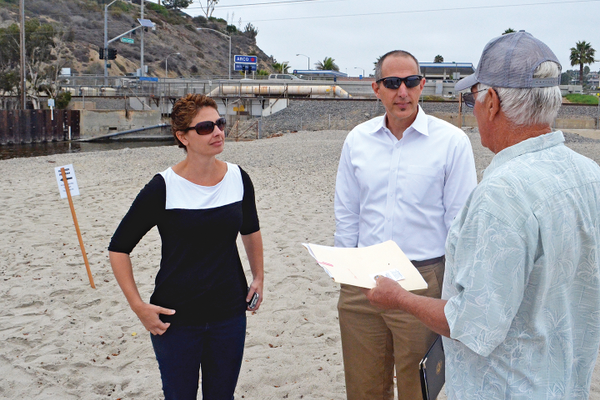 Environmental Analyst Mary Vondrak (left) and Assistant City Engineer Tom Bonigut discuss alternatives for Poche with local resident Jay Longley.