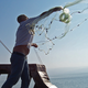Fishermen cast their nets into the sea of Galilee.