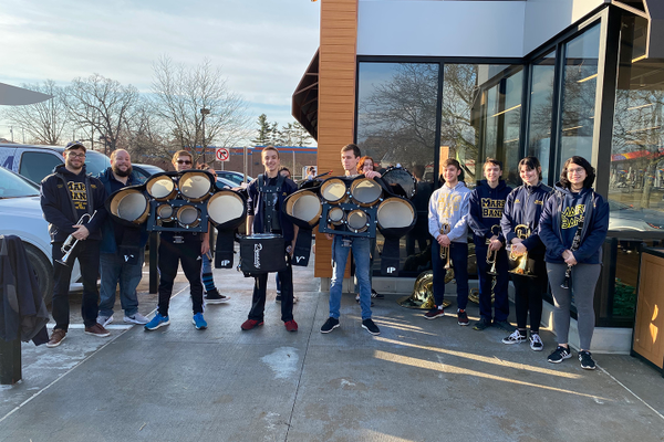 The Mars High School Marching Band played to a crowd of more than 70 people at the American Natural Cranberry grand opening ceremony on March 2.