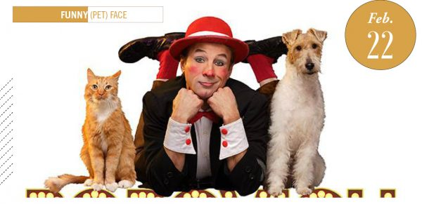 Gregory Popovich, dressed in clown face, with a cat on the left and a dog on the right