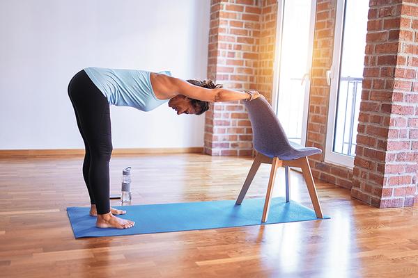 Yogi Practicing Adaptive Yoga