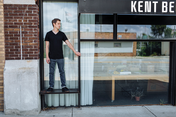 Joe Pankowski in front of Kent Bellows Studio
