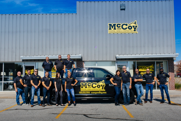 staff of McCoy Roofing, with truck