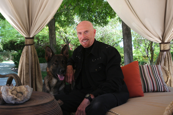Terry Goodkind with his German Shepherd
