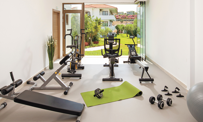 Eco-friendly green home workout room with exercise equipment