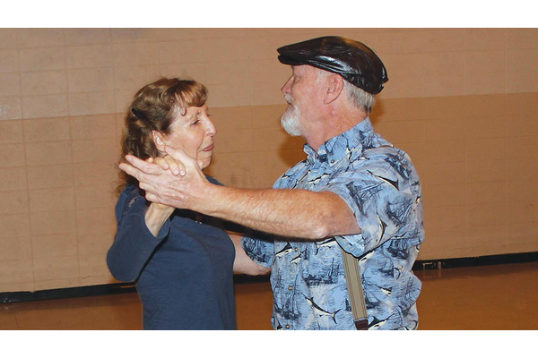 San Juan Dance Club Board members Pat Douglas and Ron Black dance together