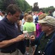 Congressional candidate Richard Tisei, left, attended the Tewksbury Memorial Day 5K Fun Run. Here, he speaks with a resident.