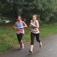 Melissa Wiles and Katelyn Walsh spring to the end of the Tewksbury Memorial Day 5K Fun Run.