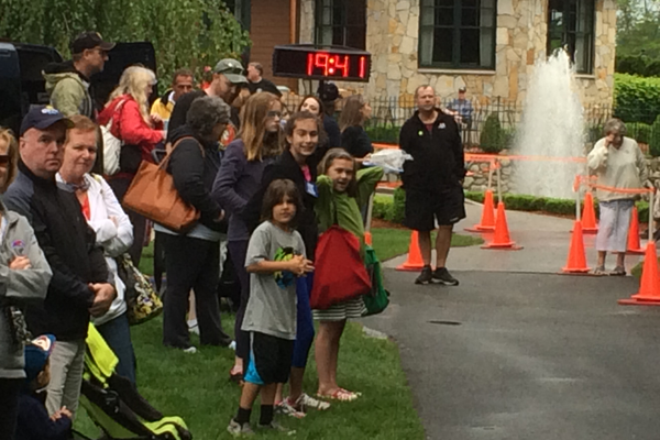 Fans cheer on the runners at the Tewksbury Memorial Day 5K Fun Run.