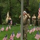 Veterans Agent Jim Williams lowers the flag to half staff at the Tewksbury Memorial Day Ceremony.
