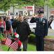 Grand Marshal Sal Pilla (left) and General Matthew Thornton salute at veteran's memorial