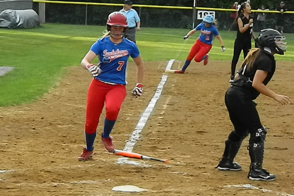 Teagan Trant (7) scores Tewksbury's first run with Anna Sessa (2) not far behind on a two-run single from Kayla VonKahle
